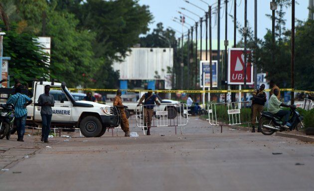 Burkina Faso gendarmes stand at a checkpost in Ouagadougou on Aug. 14, 2017, a day after a deadly attack...