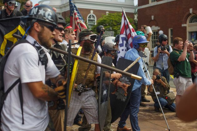 White Supremacists form a phalanx against counter protesters on Aug. 12 2017 in Charlottesville, Virginia,