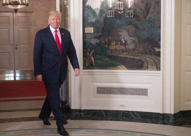 U.S. President Donald Trump arrives to make a statement in the Diplomatic Room at the White House in...