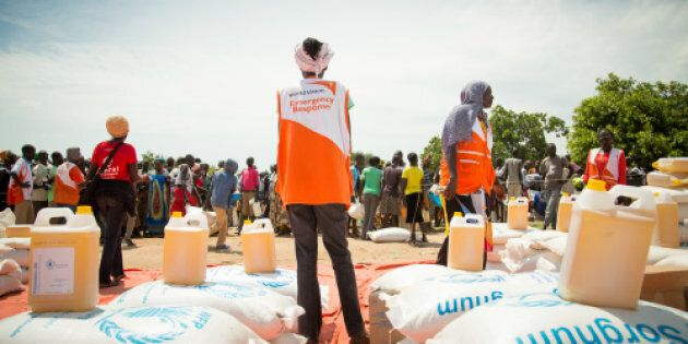 World Vision aid workers supervise food aid at Bidibidi refugee settlement in
