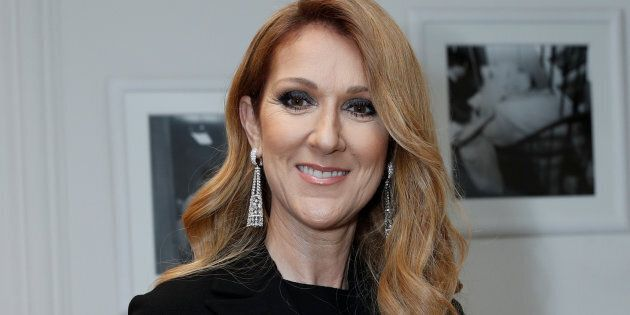 Singer Celine Dion poses before attending the Dior Haute Couture Fall Winter 2016/2017 fashion show in Paris on July 4, 2016.