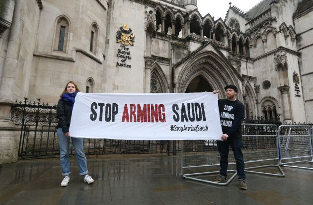 Campaigners hold a banner outside the High Court in central London, England on Feb. 7, 2017 where the legality of U.K. arms exports to Saudi Arabia is under challenge.