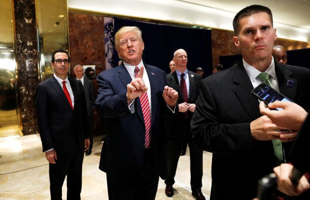U.S. President Donald Trump stops to respond to more questions about his responses to the violence, injuries...