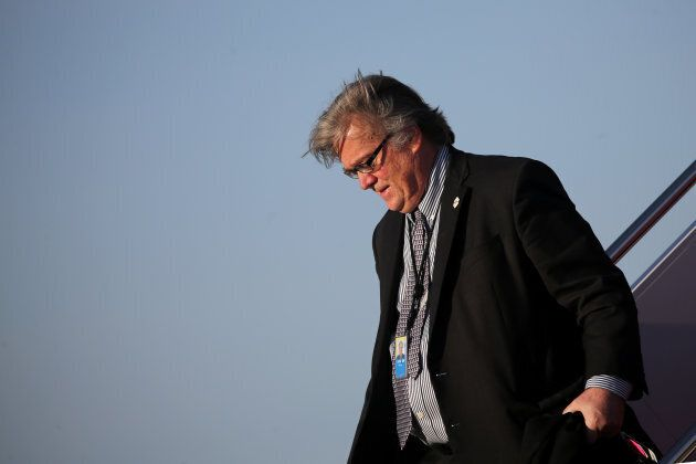 White House chief strategist Steve Bannon arrives aboard Air Force One at Joint Base Andrews, Maryland,...