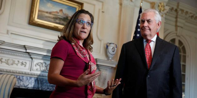 U.S. Secretary of State Rex Tillerson looks on as Canadian Foreign Affairs Minister Chrystia Freeland...