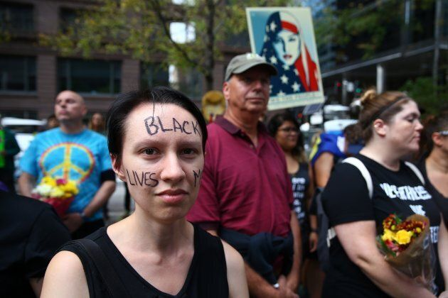 A woman with 'Black Lives Matter' written on her face attends a protest in response to violence erupting at the rally in Charlottesville, at Federal Plaza Square in Chicago, United States on Aug. 13, 2017. People from different ethnicities and groups gathered to defend and demand peace against the hate crimes and racists acts ending up in violent consequences.