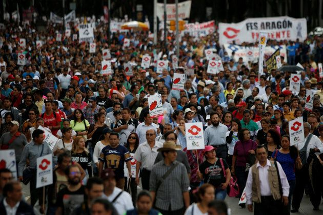 Union workers and farmers protest as NAFTA renegotiation begins in Washington, D.C., in Mexico City,...