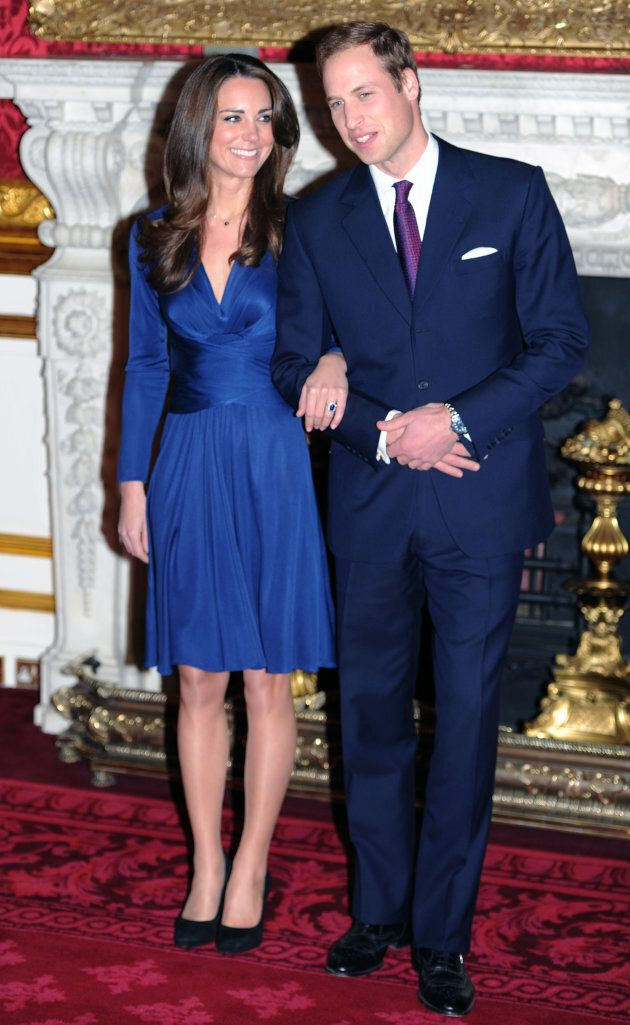 Prince William and Kate Middleton pose for photographs following the announcement of their engagement,...