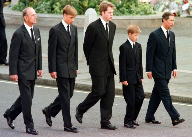 (L to R) The Duke of Edinburgh, Prince William, Earl Spencer, Prince Harry and Prince Charles walk outside Westminster Abbey during the funeral service for Diana.  (Photo credit should read JEFF J. MITCHELL/AFP/Getty Images)