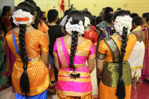 Tamil Hindu children listen to prayers after performing a Bharatnatyam dance during the Nambiyaandaar Nambi Ustavam Thiruvizha pooja at a Hindu Temple in Ontario on July 19, 2017. This pooja is part of the 15-day long festival that honours Lord Ganesh which culminates  with the extravagant chariot procession.