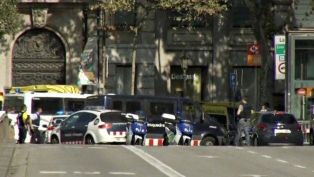 A still image from video shows a police cordon on a street in Barcelona, Spain following a van crash on Thursday.