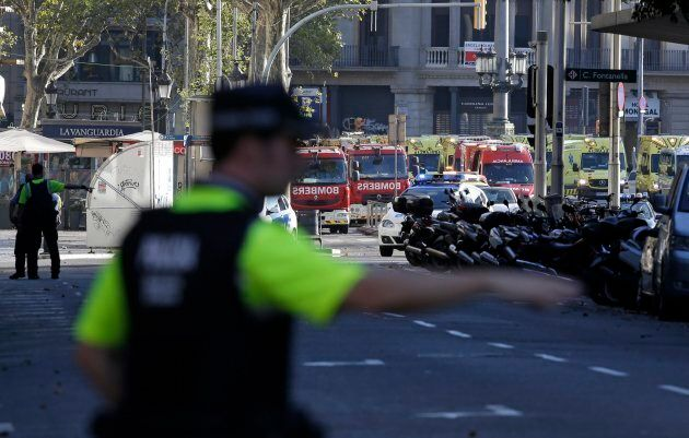 A police officer gestures as he blocks a street in Barcelona on Thursday.