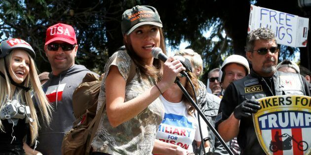 Faith Goldy, centre, a Canadian right-wing social and political commentator speaks to supporters of U.S....