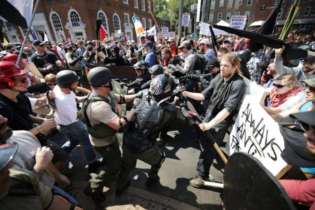 White nationalists, neo-Nazis and members of the alt-right clash with counter-protesters as they enter...