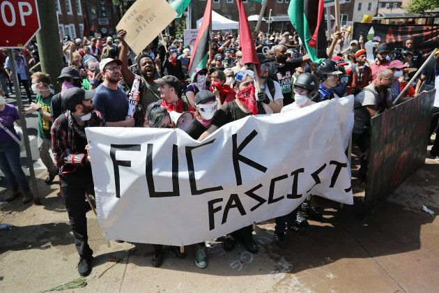 Anti-fascist counter-protesters gather outside Emancipation Park and hurl insults as white nationalists,...