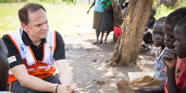 World Vision President Michael Messenger listens to the stories of refugee