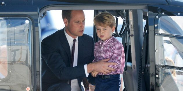 Prince George of Cambridge, Prince William, Duke of Cambridge look in a helicopter as they depart from...