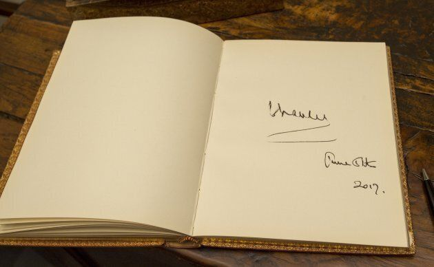 Prince Charles, President of The National Trust signature in the visitors book during a visit to Chartwell...