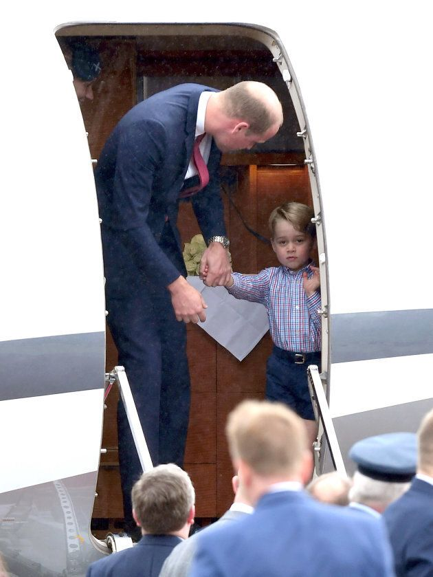 Prince George and Prince William arrive at Warsaw airport on July 17, 2017. (Photo by Karwai