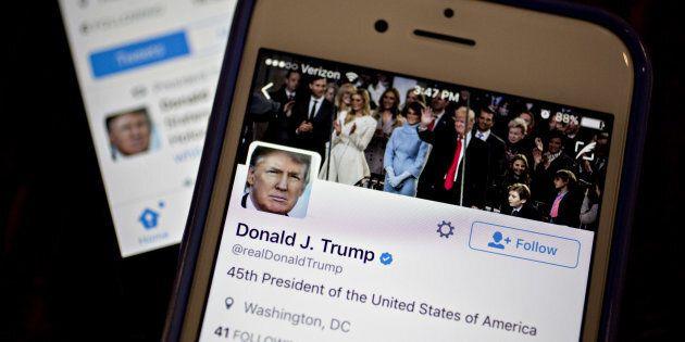 The Twitter Inc. accounts of U.S. President Donald Trump, @POTUS and @realDoanldTrump, are seen on an Apple Inc. iPhone.