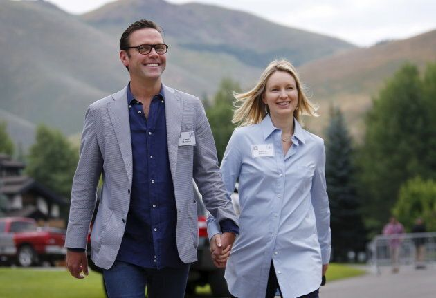 21st Century Fox CEO James Murdoch walks with his wife Kathryn as they arrive for the first day of the...