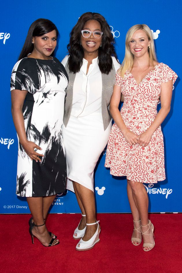 Mindy Kaling, Oprah Winfrey and Reese Witherspoon are seen at the D23 EXPO in Anaheim, Calif. on July...