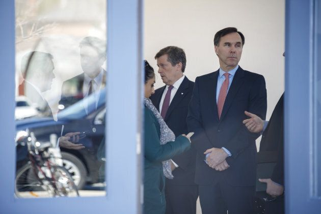 Bill Morneau, Canada's finance minister, right, stands after a meeting in Toronto, Ont. on April 18,