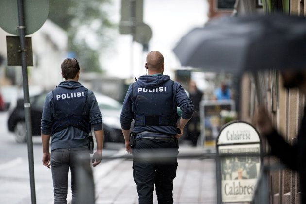 Police officers patrol in Central Turku after several people were stabbed at Turku Market Square, in...