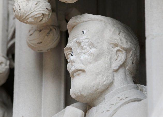 A statue on the portal of Duke University Chapel bearing the likeness of Confederate General Robert E....