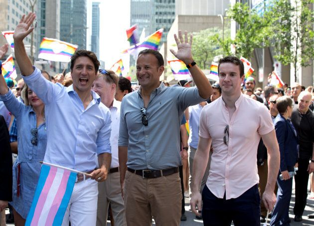 Prime Minister Justin Trudeau walks with his Irish counterpart Taoiseach Leo Varadkar and his partner...