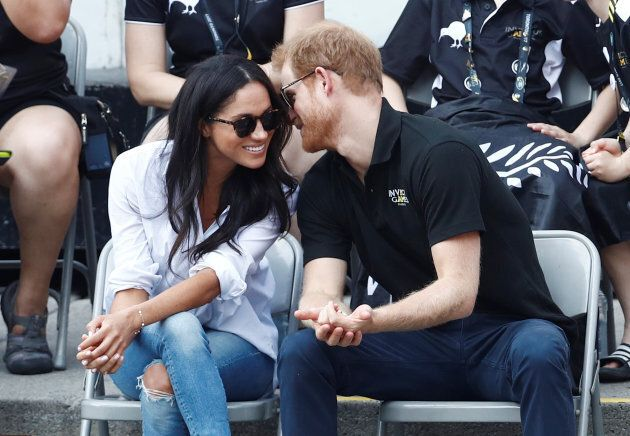 Prince Harry and his girlfriend actress Meghan Markle watch the wheelchair tennis event during the Invictus...
