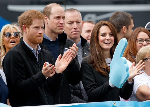 Prince Harry, Prince William, Duke of Cambridge and Catherine, Duchess of Cambridge (wearing a giant...