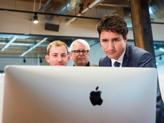 Prime Minister Justin Trudeau, right, and Michael Kitchen, CEO of Wealthsimple, left, and MP Adam Vaughan,...