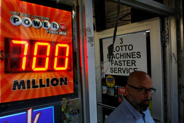A screen displays the value of the Powerball jackpot at a store in New York City, U.S., August 22,
