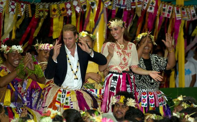 The Duke and Duchess of Cambridge dance with local ladies at a Vaiku Falekaupule Ceremony during the Royal couple's tour of the Far East in 2012 in Funafuti, Tuvalu. (Photo by Samir Hussein/WireImage)