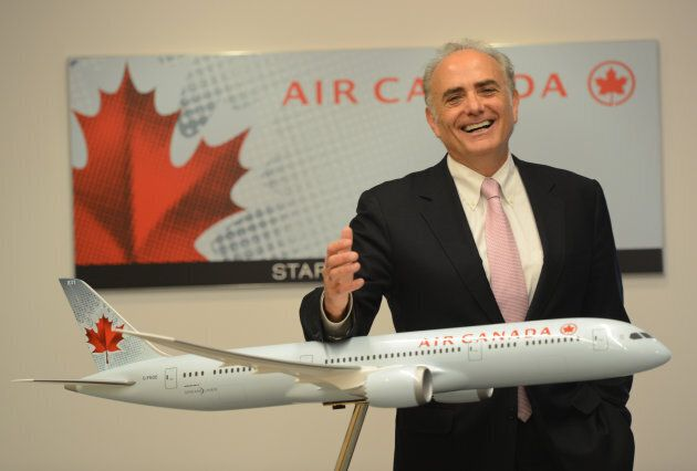 Air Canada CEO Calin Rovinescu stands next to a model of the Boeing 787 Dreamliner at the Air Canada...