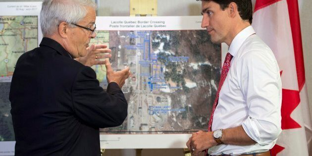 Prime Minister Justin Trudeau is briefed on the refugee installations at the Lacolle border crossing...