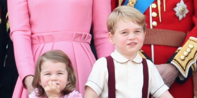 Prince George and Princess Charlotte look out from the balcony of Buckingham Palace during the Trooping...