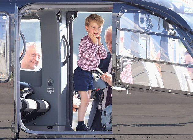 Prince George viewing helicopter models H145 and H135 before departing from Hamburg airport on the last...