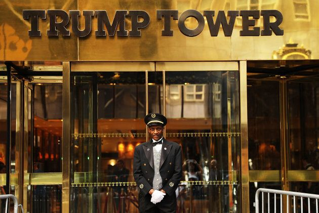 A doorman stands in front of Trump Tower along Fifth Avenue on Aug. 14, 2017 in New York