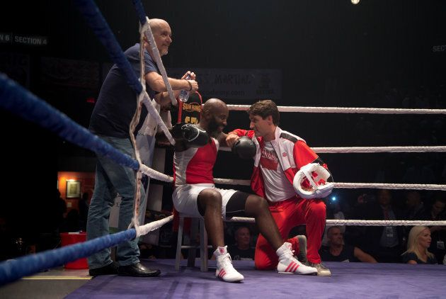 Prime Minister Justin Trudeau coaches in the corner with boxer Ali Nestor during a charity event in Montreal...