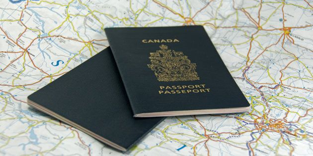 A pair of closed Canadian passports laid upon a