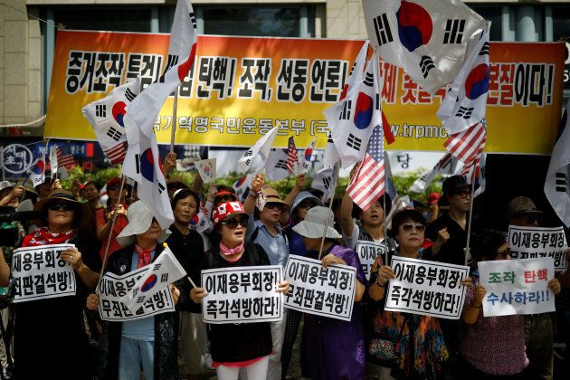Protesters from a conservative group that supports South Korean ousted leader Park Geun-hye attend a...