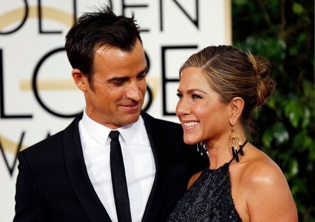 Justin Theroux and Jennifer Aniston arrive at the 72nd Golden Globe Awards in Beverly Hills, California, January 11, 2015. (REUTERS/Mario Anzuoni)