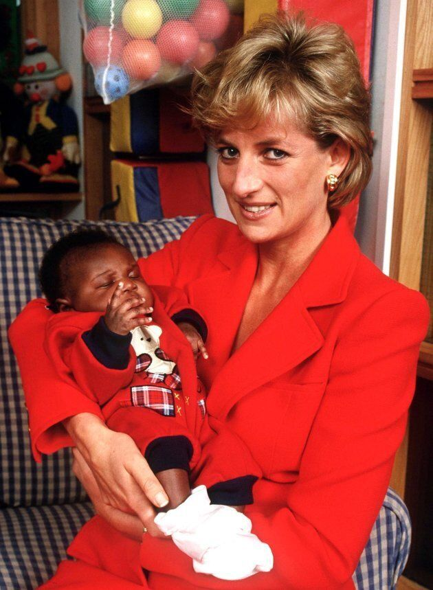 Princess Diana holding eight week old baby Tamara at the London Lighthouse, a centre for people affected...