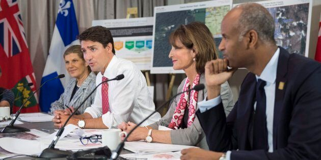 Prime Minister Justin Trudeau is joined by Laura Albanese (left), Ontario Minister of Citizenship, Kathleen Weil, Quebec Minister of Immigration, Diversity and Inclusiveness, and Ahmed Hussen, right, Federal Minister of Immigration, Refugees and Citizenship, in a meeting of the Intergovernmental Task Force on Irregular Migration on Aug. 23, 2017 in Montreal.