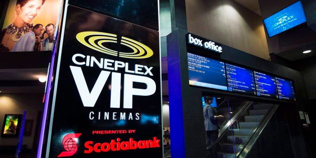 An employee makes her way up the escalator during the Cineplex Entertainment company's annual general...