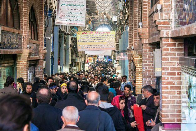 People in Tehran's central bazaar, February 21, 2013. Authorities in Iran say Apple has shut down its...