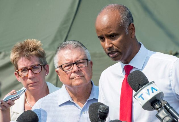 Immigration Minister Ahmed Hussen, right, Public Safety Minister Ralph Goodale and Quebec Liberal MP Brenda Shanahan speak to media on Aug. 21 2017 near Saint-Bernard-de-Lacolle, Que.