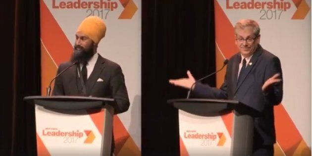 NDP leadership hopeful Charlie Angus shrugs after an answer from rival Jagmeet Singh at a debate in Montreal on Aug. 27, 2017.
